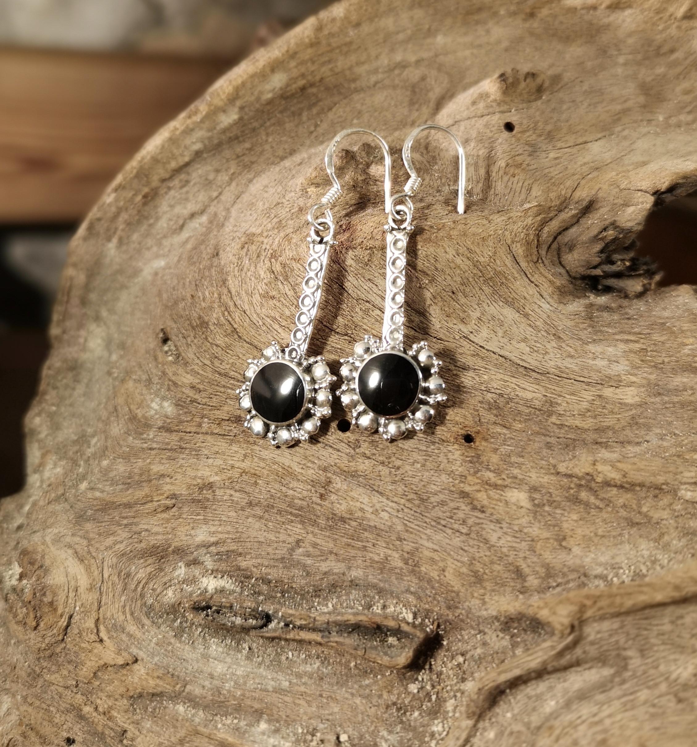 Long ornate drop earring