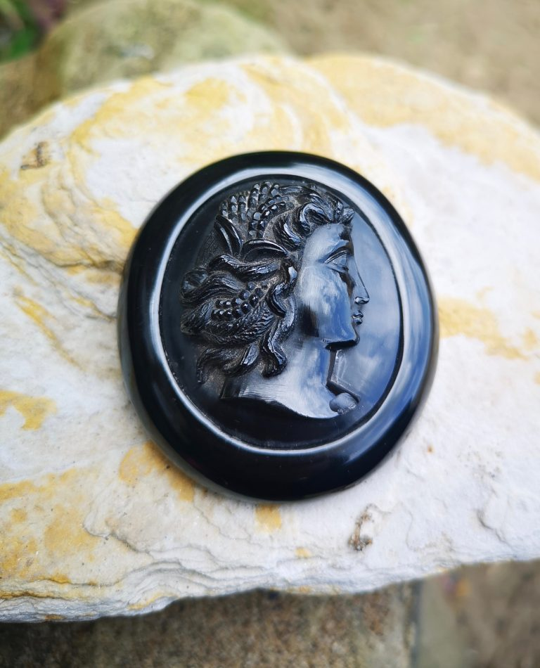 "Antique Whitby Jet cameo ""lady with grapes"""