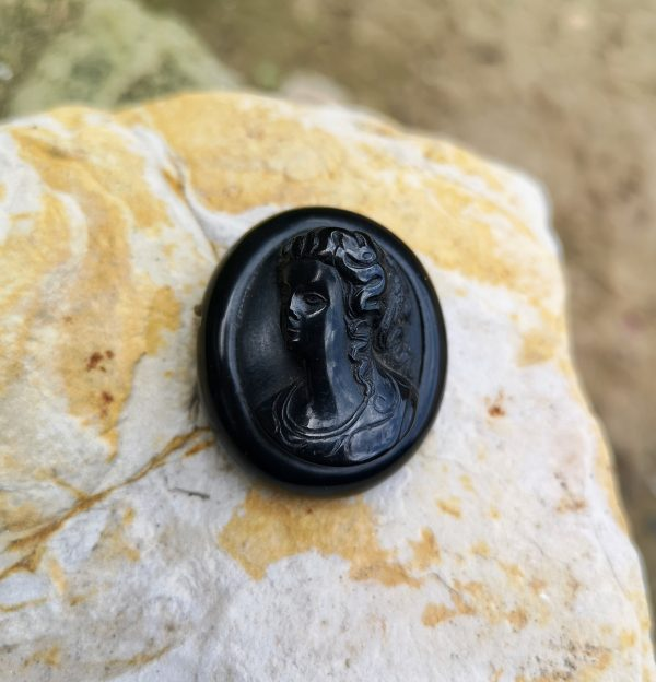 Antique Whitby Jet Cameo brooch.