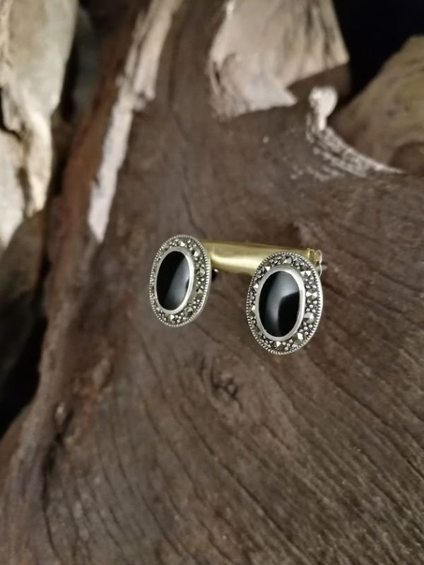 Whitby Jet Stud earrings set in a decorative sterling silver surround.