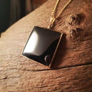 Large gold and Whitby Jet pendant.