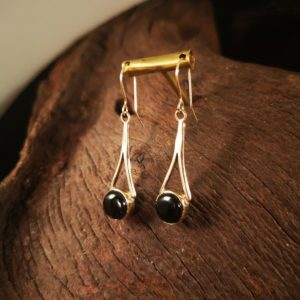 Gold and Whitby Jet dangly earrings.