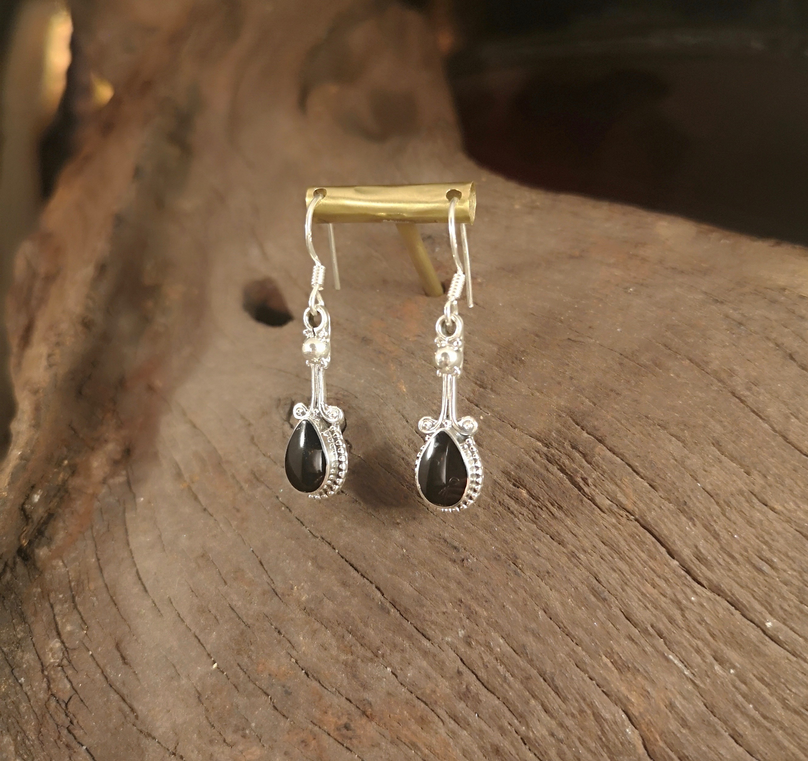 Scroll on stalk teardrop earrings