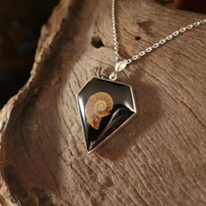 Diamond shaped Whitby Jet pendant with Ammonite inlay.