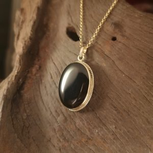 gold Whitby Jet oval pendant