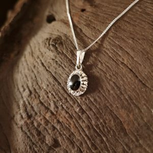 Sterling silver and Whitby Jet oval pendant.