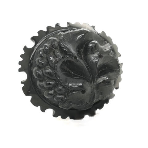 Antique Victorian Whitby Jet brooch with floral symbolic carving.