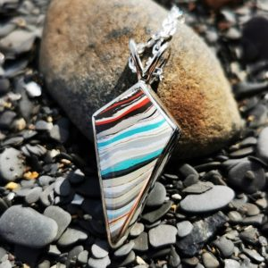 Fordite pendant and Whitby Jet double sided