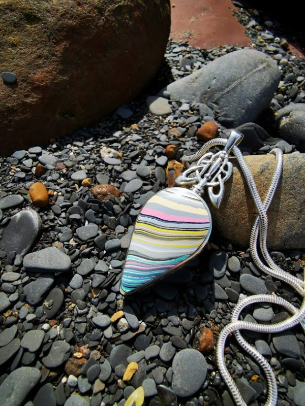 Fordite double sided pendant