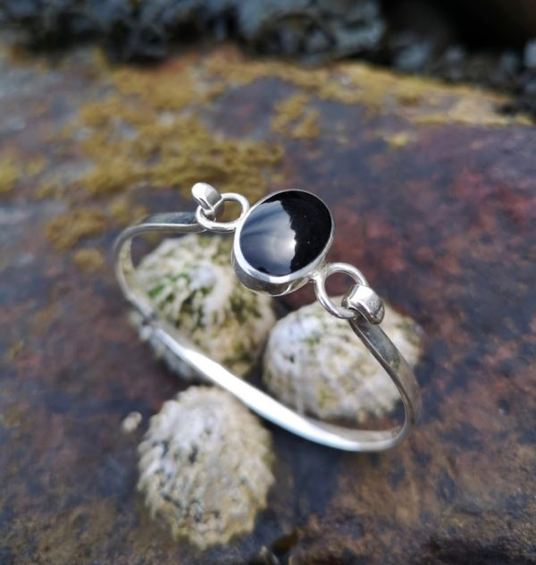 Whitby Jet Bangle set in an oval sterling silver setting