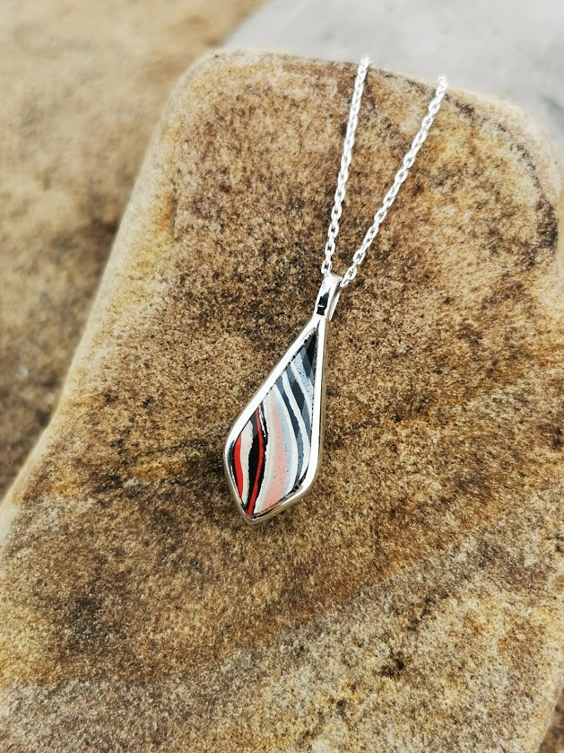Fordite and Whitby Jet double sided drop pendant