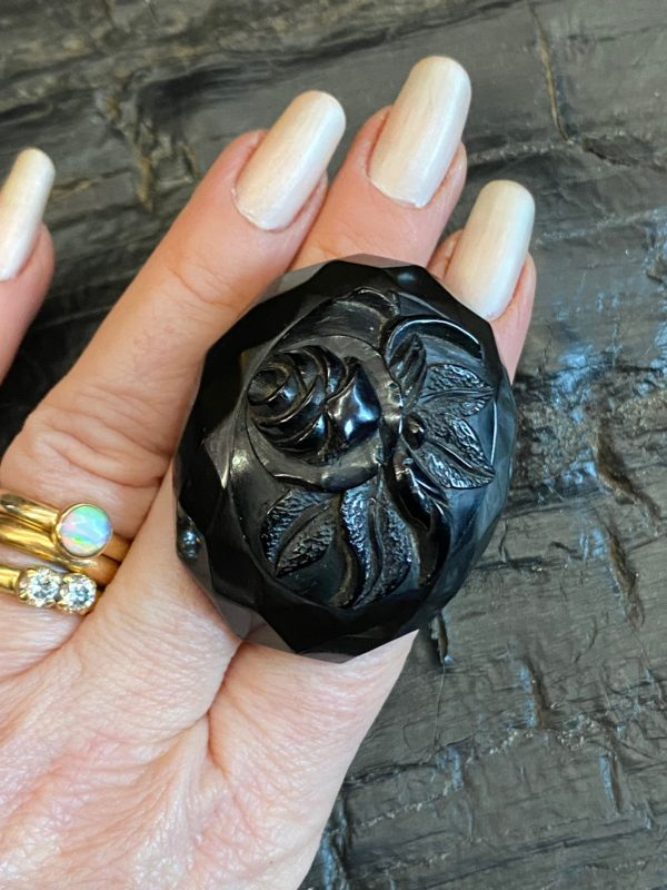 Antique Victorian Whitby Jet Brooch with carved rose and facetted edge.